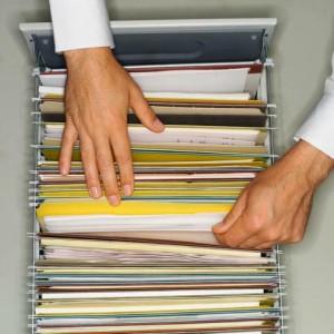 Businessman Filing Information