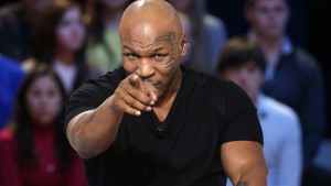 "US Former heavyweight boxing champion Mike Tyson attends the TV show ""Le Grand Journal"" on the French television channel Canal Plus on December 9, 2013 in Paris.    AFP PHOTO / THOMAS SAMSON"